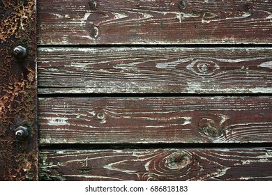 Wooden background from old plank boards with iron fastening, horizontal arrangement in a row