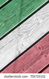 Wooden background painted in the colors of the Italia flag. Natural photo.