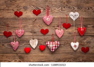 wooden background with red valentine hearts. Holiday concept
