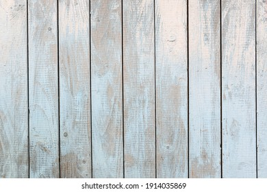 Wooden background for shooting, pastel colors, paint peels off.