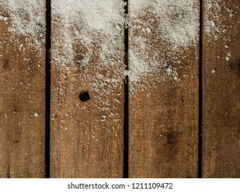 Wooden background with snow on top. copy space left for text and images