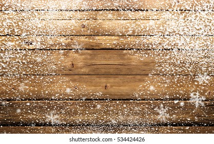 wooden background with snowflakes