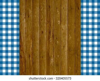 Wooden background with two blue white stripes tablecloths