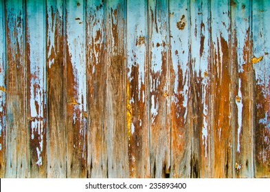wooden background of wall with rusty nails
