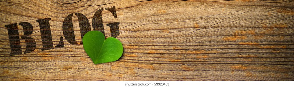 wooden background with the word blog and green heart - horizontal banner
