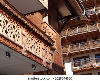 Wooden balconies on traditional chalets in small alpine village of Chatel, France