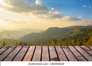 Wooden balcony with a beautiful view of the mountain, the valley in the evening, sunset