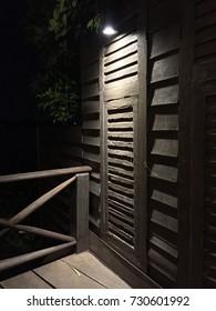 Wooden Balcony Corner under the light.