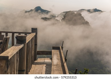 wooden balcony with mountain view and morning fog on sunrise sunrise in northern Thailand