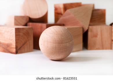 wooden ball on a background of geometric shapes
