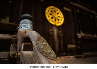 Wooden banister with hearts on its metalwork, leading up alongside stairs to the entrance doors to Kaizando Hall in Naritasan Shinsoji Buddhist Temple in Narita, Chiba, Japan