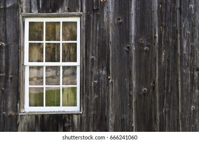Wooden barn siding and window texture background