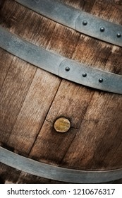 Wooden barrel background in a French cellar