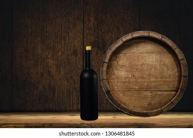Wooden barrel and black wine bottle on a old oak table of wood.