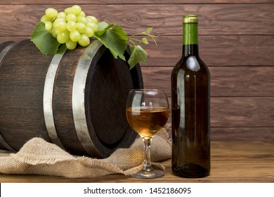 Wooden barrel with bottle and glass of wine