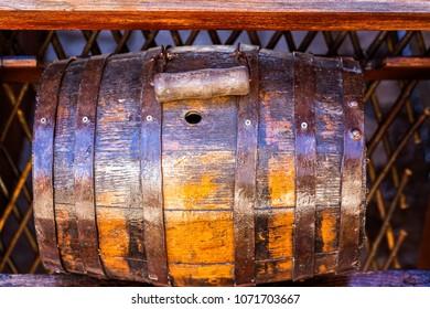 Wooden barrel on a dark wooden background.