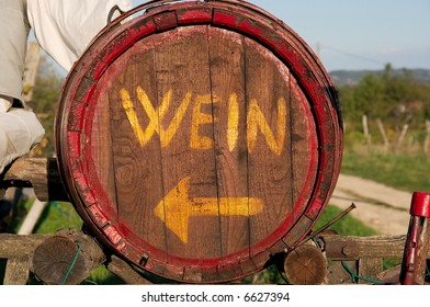 "Wooden barrel with ""WEIN"" written on it and arrow indicating the direction"