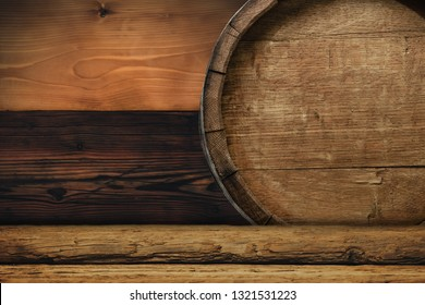 Wooden barrel and worn old table of wood.