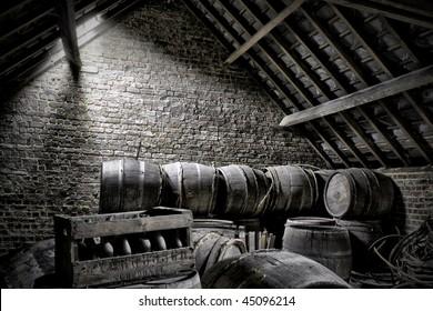 wooden barrels at an attic