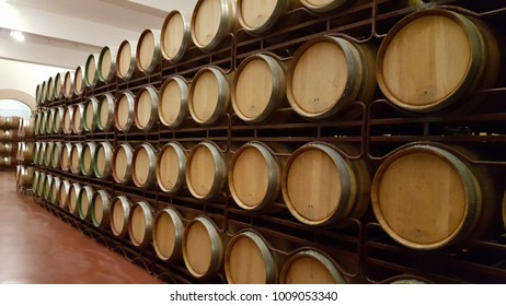Wooden barrels stacked in cellar