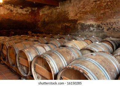 Wooden barrels in a wine cellar in a winery