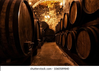 Wooden barrels with wine in a wine vault