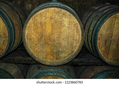 Wooden barrels at the winery. Old wooden barrels for Cognac, Wine or Whiskey