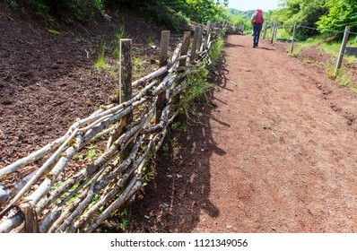 wooden barriers and blured hiker