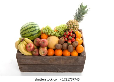 Wooden basket filled with fresh fruit over white background