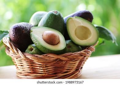 wooden basket full avocados fruit