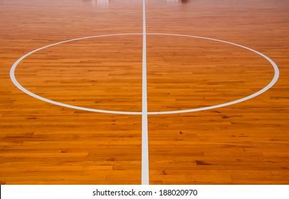Wooden basketball court at center