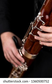 Wooden bassoon isolated on a black background. Musical instruments. Musician playing the instrument.
