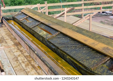 Wooden bath for impregnation of building boards with antiseptic protective. Covers antiseptic boards.