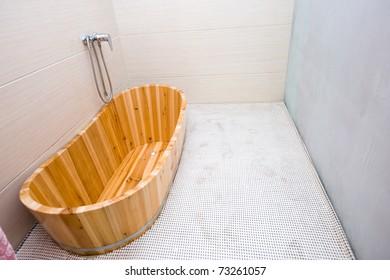 wooden bathtub in a bathroom.