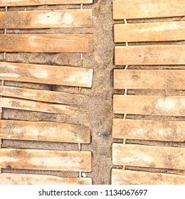Wooden beach boardwalk with sand