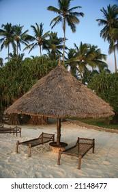 A wooden Beach Hut on a sandy beach in Africa.