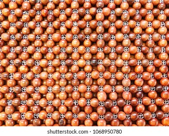 Wooden beads mat background, for backgrounds or textures