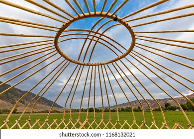 Wooden beams and dome of a nomadic tent known as yurt, under construction, in Kazakhstan