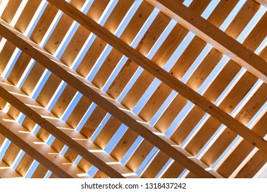 Wooden beams on blue sky background on Sunny day. Natural photo.