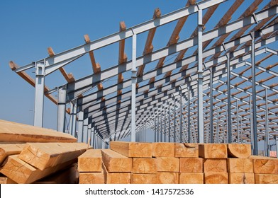 Wooden beams for steel structure for further construction. Metal frame for the installation of insulation panels. Construction of pre-fabricated buildings.