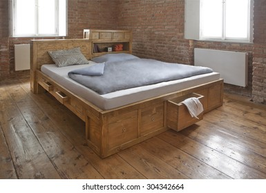wooden bed with drawer