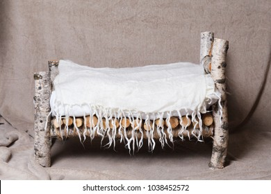 Wooden bed made of birch for newborn. Decor elements
