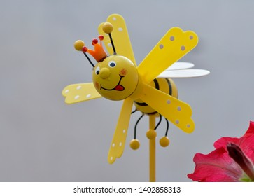 Wooden bee with propeller to scare insects