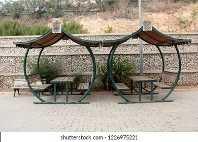 wooden bench and arbor