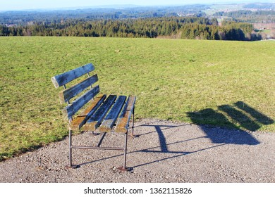 Wooden bench in beautiful panorama landscape in the hilly alpine upland, Allgäu, Bavaria