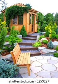Wooden bench and cabin in a garden