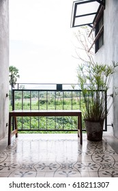 Wooden bench at the corridor for enjoying the view