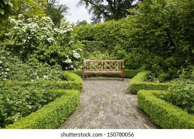 Wooden bench in a formal garden