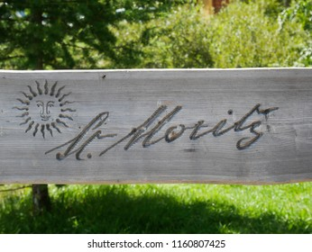 "wooden bench with the inscription ""Saintz Moritz"""