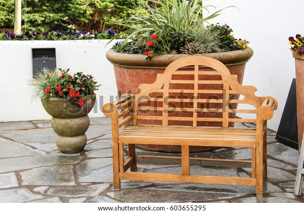 Peachy Wooden Bench Large Plant Pot Behind Stock Photo Edit Now Caraccident5 Cool Chair Designs And Ideas Caraccident5Info